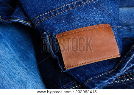Blue Jeans Pants With Back Pocket And Empty Brown Tag. Blank Leather Jeans Label Sewed On Pants. Cas