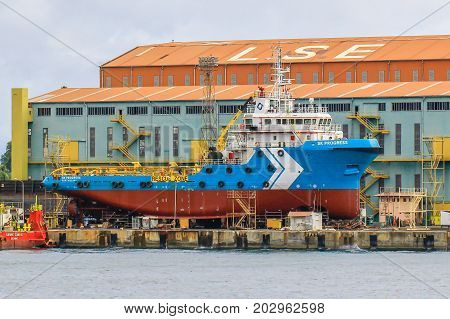 Labuan,Malaysia-Aug 30,2017:Ship in the dock dry under repairing in shipyard at Labuan,Malaysia.
