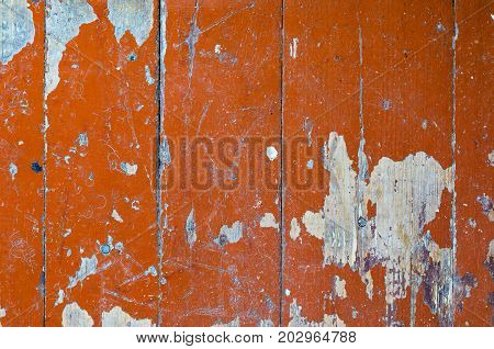 Texture of old dilapidated wooden floor with brown peeling paint. Exfoliated Paint on an Old Wooden Floor. Shabby Background