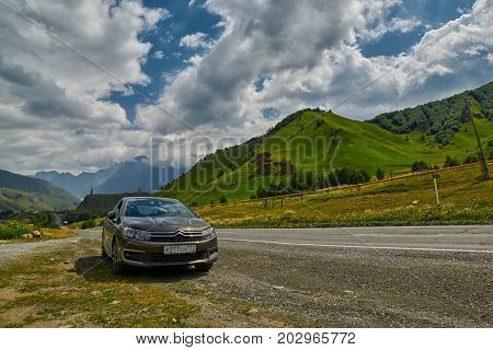 GEORGIAN MILITARY ROAD, GEORGIA - 29 JULY 2017: Citroen car against Georgian Military Road Background