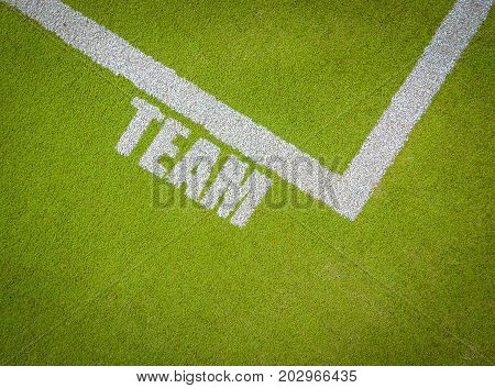White Markings On A Sports Pitch Or Court Saying Team With Copy Space