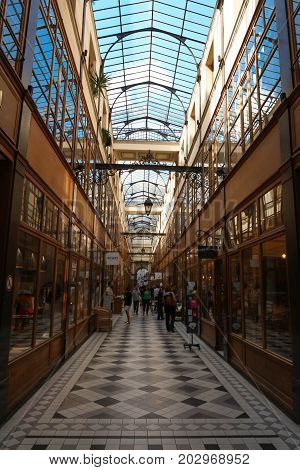 PARIS, FRANCE - SEPTEMBER 2, 2017: Grand Cerf covered arcade was created in 1825, not far from Turbigo , Montorgueil district. It is almost 12 m tall, making it one of the largest covered arcades in Paris.