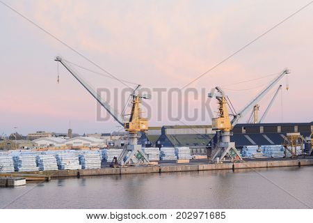 SAINT-MALO FRANCE - NOVEMBER 27 2016: Port in Saint Malo Ship cargo containers and yellow cranes in Saint-Malo France.