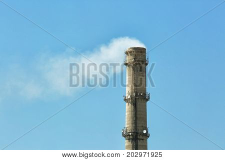 Flue of industrial factory on sky background