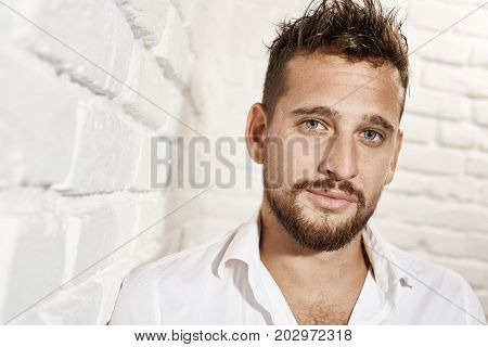 Portrait of goodlooking young caucasian man looking at the camera.
