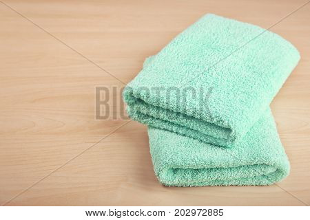 Clean towels on wooden table