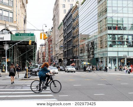 New York USA - 27 September 2016: A cyclist makes her way along W Houston St in downtown Manhattan in New York City.