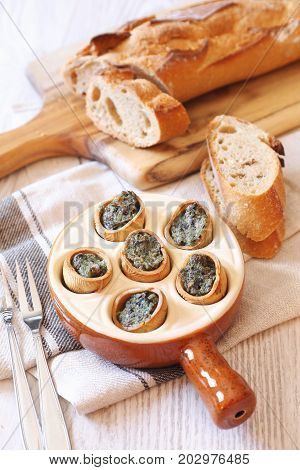 Escargots traditional French dish: snails and baguette
