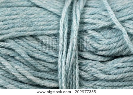 A super close up image of gray blue yarn