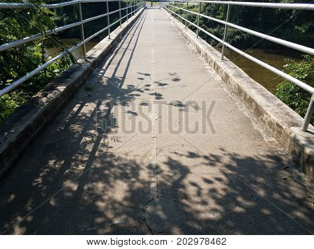 trail on a bridge with metal hand rails