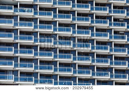 Rows of balconies on a  modern hotel building in Tel Aviv, Israel.