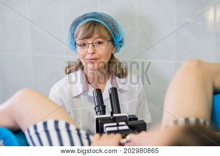 Female Gynecologist During Examination In Her Office.