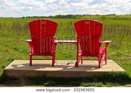 Elk Island National Park Alberta Canada - June 24 2017 - A set of chairs located on the Bison Loop Road as part of the 'Parks Canada's Red Chair Experience Program'.