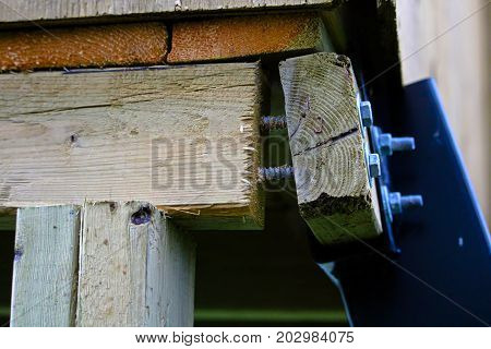 Structural Damage Where Lag Bolts Have Been Pulled Out Of A Frame