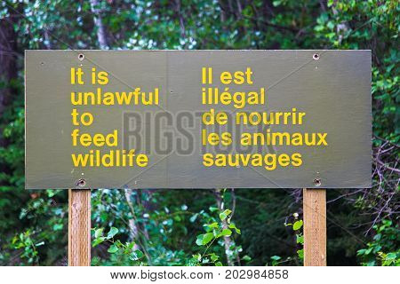 And It Is Unlawful To Feed Wildlife Sign