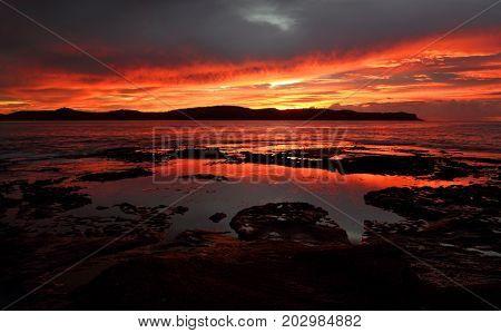 Vivid Red Dawn Scene Pearl Beach Australia