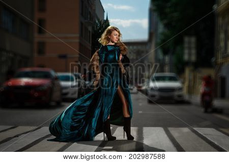 Female going on pedestrian zebra.  City life, traffic and walking concept