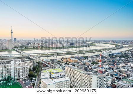 Business and culture concept - panoramic modern city skyline bird eye aerial view with tokyo skytree under dramatic sunset glow and beautiful cloudy sky in Tokyo Japan