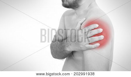 Young man suffering from pain and bruise of muscle in shoulder on white background.