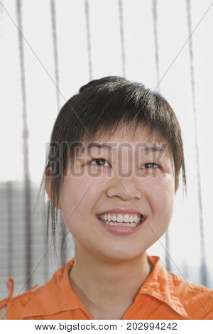 Chinese woman smiling and looking up