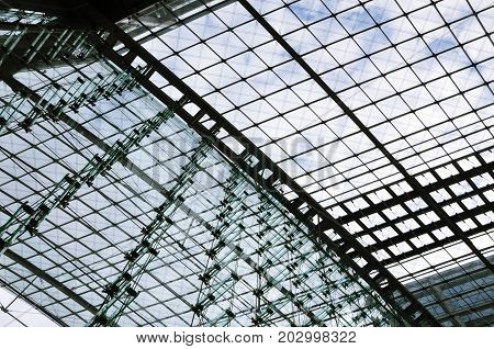 Berlin, Germany - April 14, 2017: Berlin Railway Station building. Glass wall and ceiling of metal frame and planar glazing. Look up.
