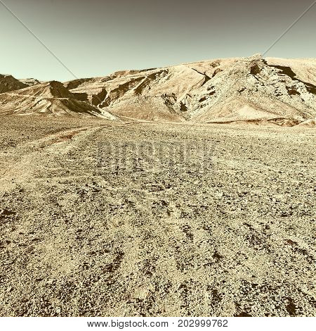 Rocky Hills of the Negev Desert in Israel Vintage Style Toned Picture