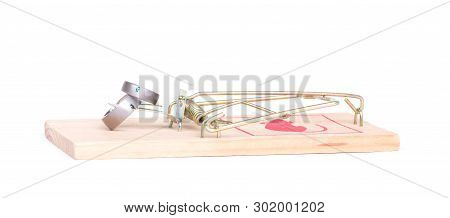Wedding rings bait in a mousetrap, concept marriage of convenience, contract - Isolated on white poster