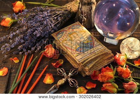 Tarot Cards With Magic Crystal Ball, Candles And Lavender Flowers. Wicca, Esoteric, Divination And O