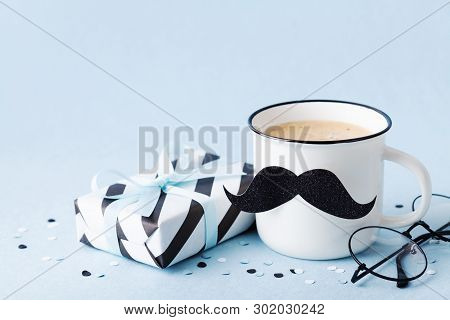 Creative Breakfast On Happy Fathers Day With Gift Box And Funny Face From Cup Of Coffee And Moustach
