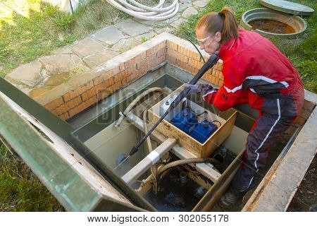 Plumber Cleans A Septic Tank Using Car Wash High Pressure. Purification Station.