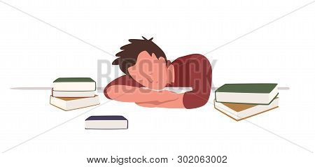 Boy Sitting At Desk And Sleeping Or Taking Nap Among Books While Preparing For School Or University