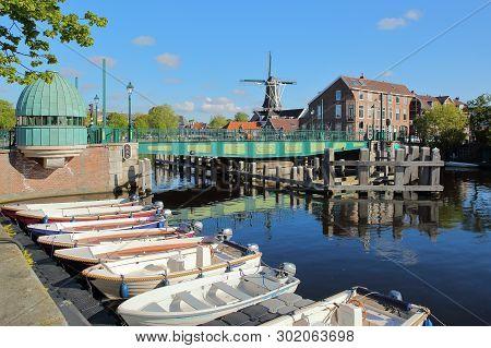 Haarlem, Netherlands - May 13, 2019: Catharijnebrug Bridge Over Spaarne River With Molen De Adriaan