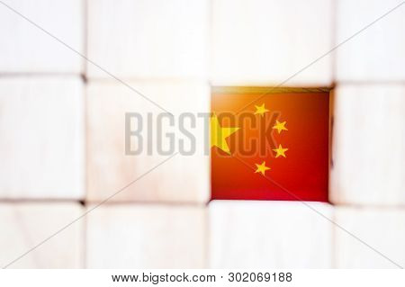 China Flag With Wooden Cube For Sign Of Communism. China Is Country Which The Highest Growth Of Econ