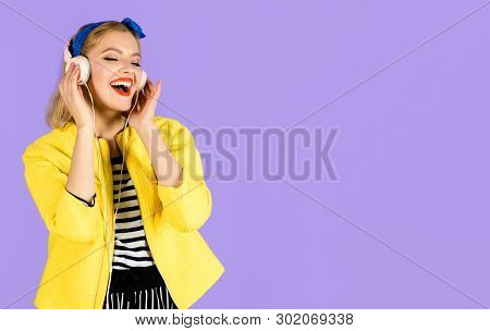 Woman With Headphones Listening Music. Sexy Girl In Yellow Jacket. Woman Enjoy Good Sound. Girl Rela