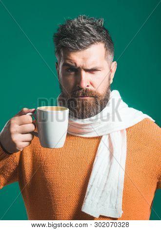 Coffee Shop. Serious Man In Sweater&scarf Enjoying Cup/mug Of Coffee/tea. Winter Or Autumn Season. B