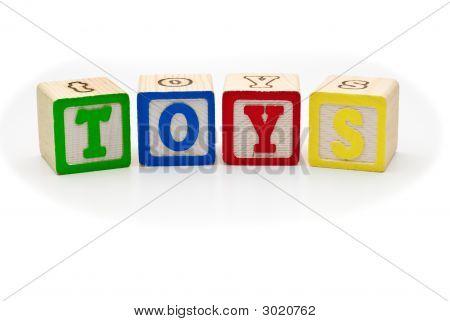 Children's Wood Blocks Spelling The Word Toys Over White