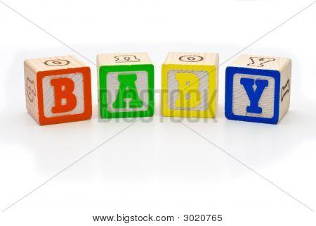 Children'S Wood Blocks Spelling The Word Baby Over White