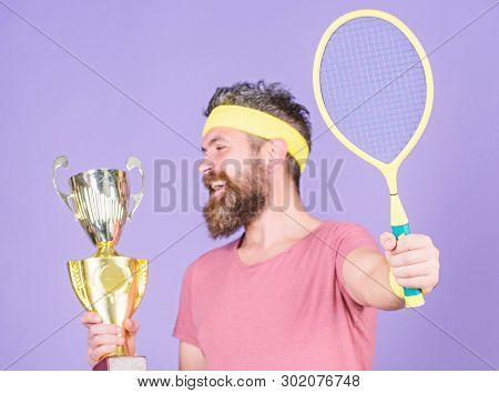 Athlete Hold Tennis Racket And Golden Goblet. Win Tennis Game. Man Bearded Hipster Wear Sport Outfit