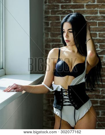 What A Slim Figure. Sensual Slim Woman Standing At Window. Sexy Model Demonstrating Sexy Slim Figure
