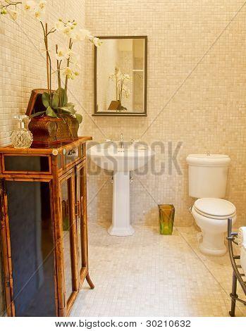 Pedastal Sink And Toilet In Bathroom