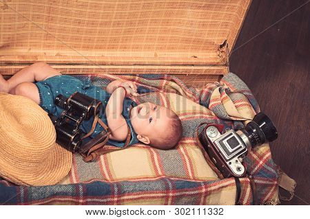 Baby Growing. Small Girl In Suitcase. Traveling And Adventure. Portrait Of Happy Little Child. Sweet