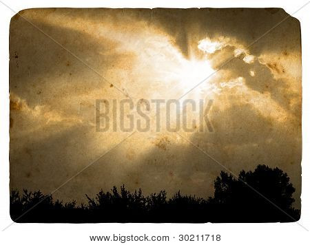 Beams of the sun closed by a cloud. Old postcard design in grunge and retro style poster