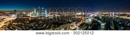 High-rise Buildings And Transport Metropolis, Traffic And Blurry Lights Of Cars On Multi-lane Highwa