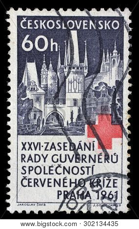 ZAGREB, CROATIA - JULY 03, 2014: a stamp printed in Czechoslovakia shows Charles Bridge, St. Nicholas Church and Hradcany at Prague, Red Cross, 26th Congress of Boards of Governors, circa 1963
