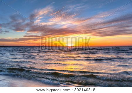 Amazing sunset at Baltic sea beach in Poland