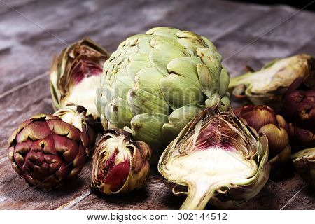 Artichokes On Grey Background. Fresh Organic Artichoke Flower Vegetable