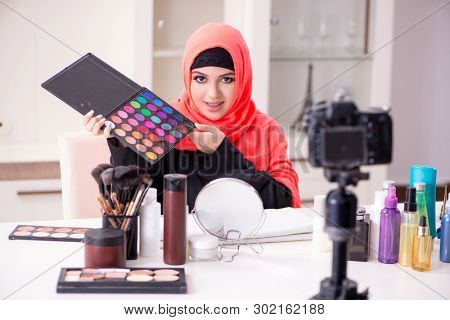 Beauty blogger in hijab recording video for her blog