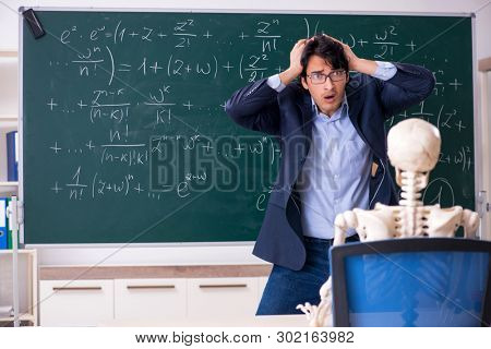Young male math teacher and student skeleton