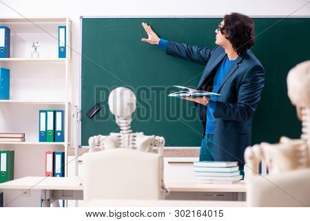 Male teacher and skeleton student in the classroom