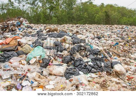 Garbage Dump Pile In Trash Dump Or Landfill,truck Is Dumping The Gabage From Municipal,pollution Con